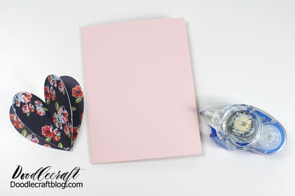 Make a simple last minute Valentine card with 3 paper hearts and Tombow adhesive.