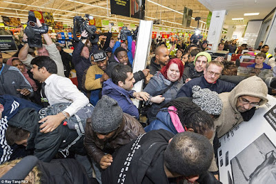 http://www.dailymail.co.uk/news/article-2852585/Mayhem-Black-Friday-begins-Shoppers-clash-supermarkets-trying-grab-bargains-Boots-Game-Curry-s-PC-world-websites-crash-thousands-start-hunt-Christmas-deals.html
