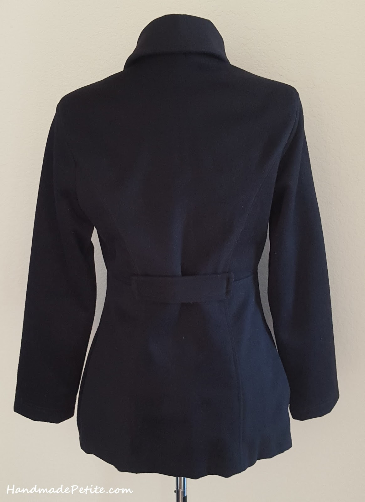 Sewn coat with added placket