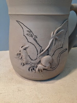 Pottery mug with dragon by Future Relics Gallery