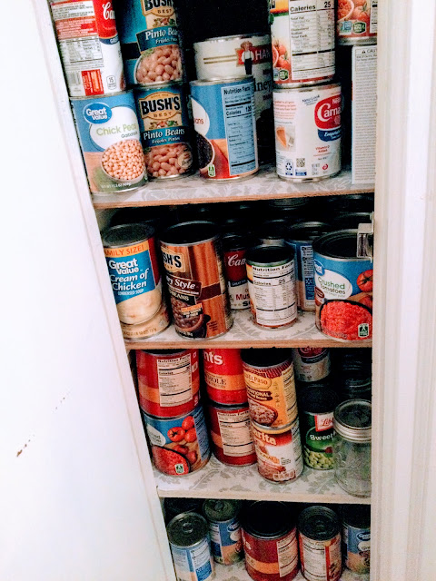 Small pantry recessed in wall