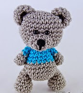 http://www.ravelry.com/patterns/library/sam-the-little-teddy-bear