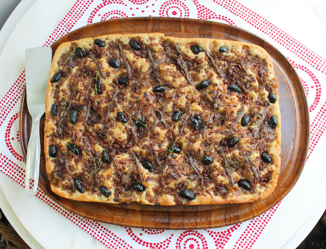 Food Lust People Love: This pissaladière or, to give it a much more descriptive name in English, Bacon Onion Anchovy Olive Tart is baked with a non-traditional sourdough crust. The bacon, anchovies and olives are beautifully salty, perfect atop the sweet onions. A square or two of pissaladière makes a great appetizer or anytime snack. If you don't have time for all the rising and resting time necessary, feel free to substitute your favorite pizza dough instead.