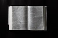 Bible epilogue - Photo by Luis Quintero on Unsplash