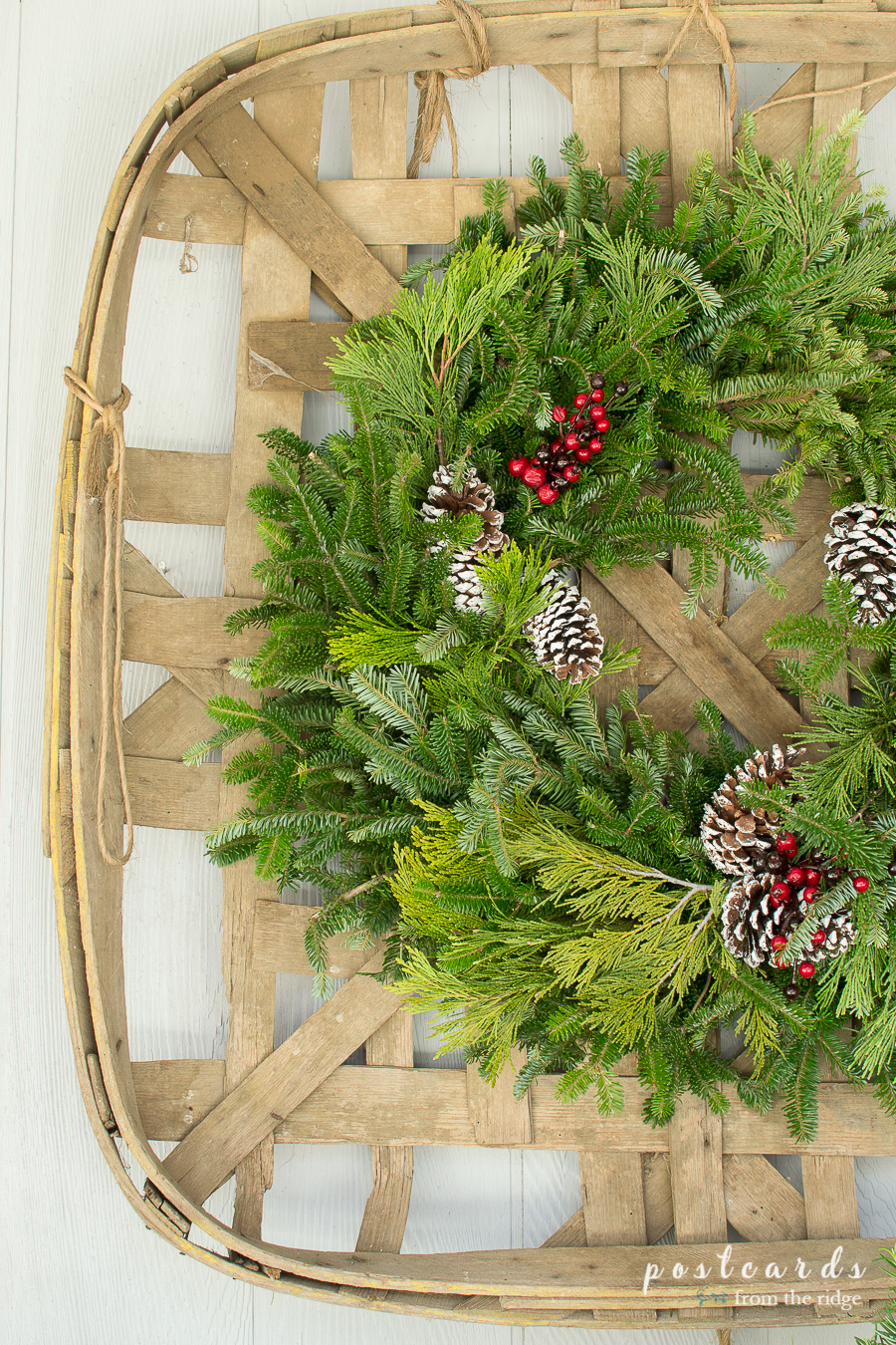 old tobacco basket with fresh green Christmas wreath