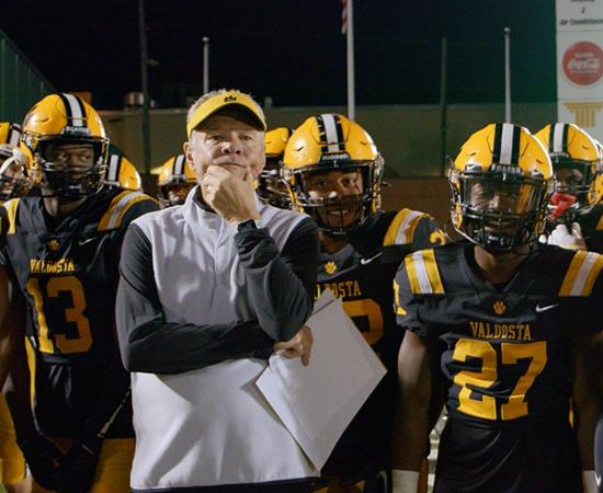 Treinador Rush Propst e seus atletas