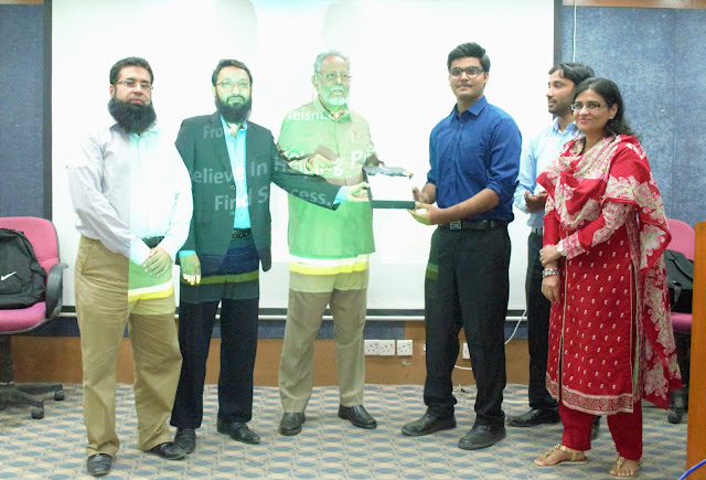 Syed Faizan Ali Receiving Award of recognition for delivering the workshop.