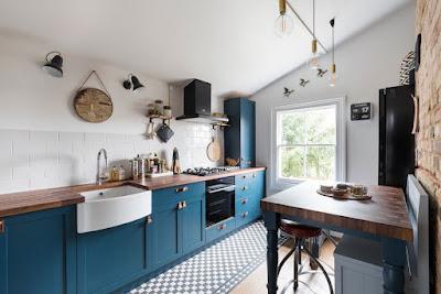 Brick wall and wooden countertop in Scandinavian kitchen design