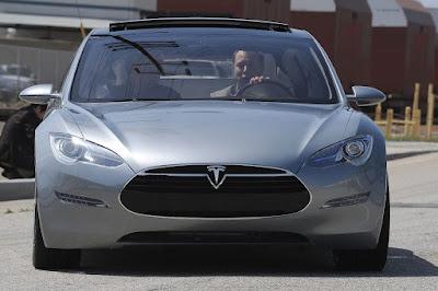 elon musk driving his car.