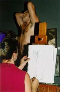art model poses for figure artist while drawing life drawing modeling