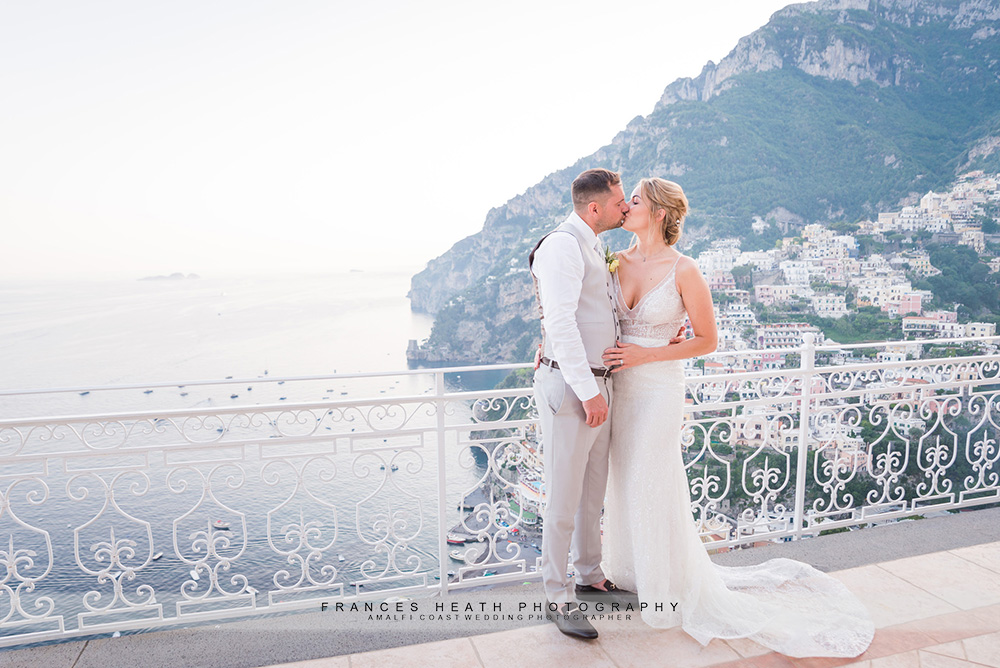 Bride and groom portrait above Positano