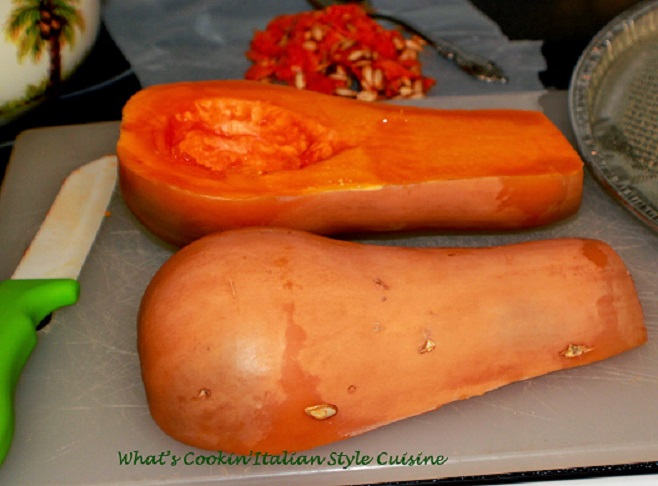this is a butternut squash sliced in half getting ready to be roasted