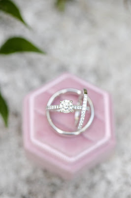 pink ring box with wedding rings