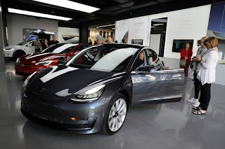 A Tesla Model 3 is seen in a showroom in Los Angeles, California U.S. January 12, 2018. (Credit: Reuters/Lucy Nicholson/File Photo) Click to Enlarge.