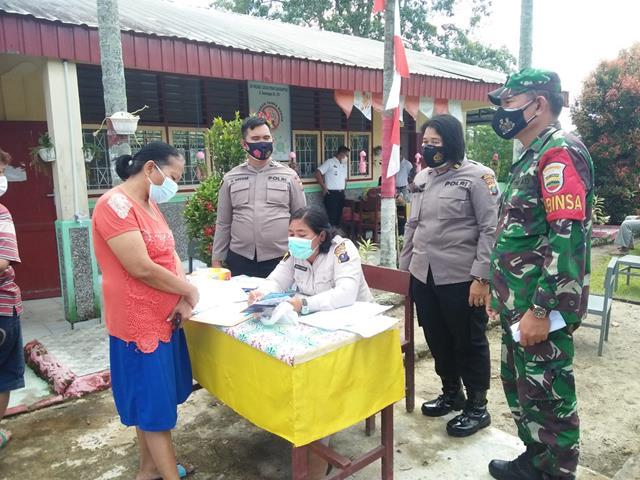 Tepatnya Dilapangan Sekolah SD Aek Nauli Pelaksanaan Vaksin Didampingi Personel Jajaran Kodim 0207/Simalungun
