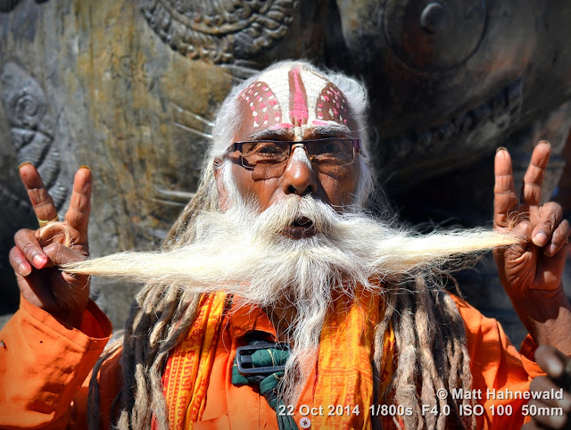 people, closeup, street portrait, Nepal, Kathmandu, sadhu, Hinduism, holy man, religious ascetic, yogī, mokṣa, double V sign, long beard