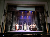 Commendatore on stage receives applause from audience