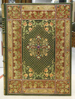 An elaborately patterned leather binding with gold-stamped patterns.