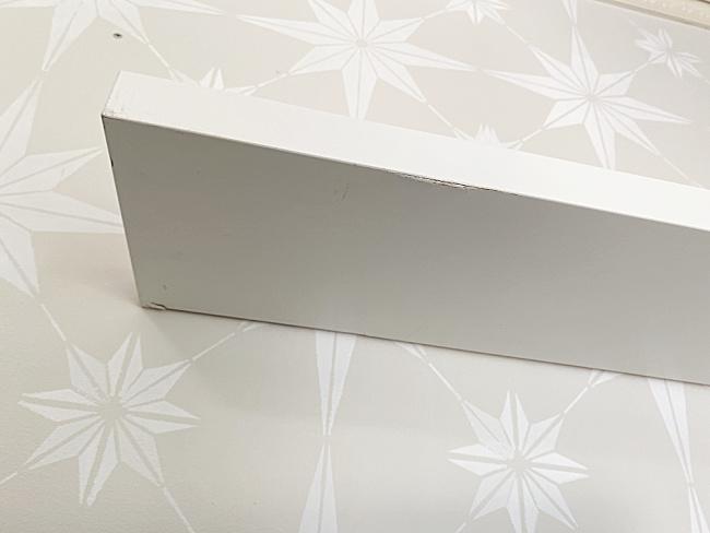 white underside of the floating shelf