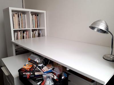IKEA white bookshelf and desk.