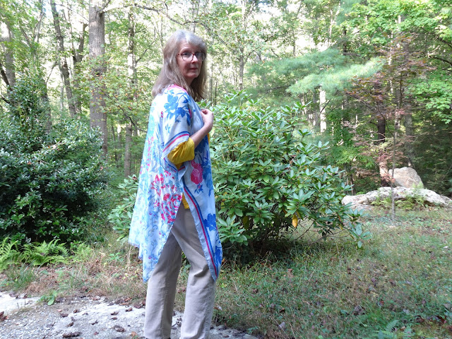 blue kimono worn with corduroy pants and blue duster