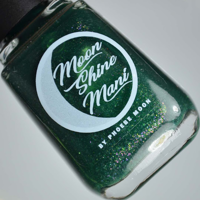 matte green nail polish with flakies in a bottle