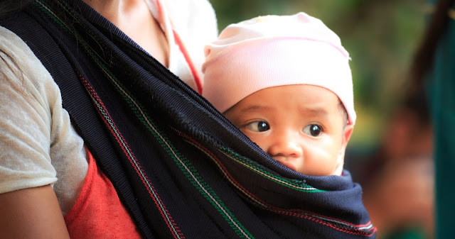 Image: Woman Carrying Baby in a Sling, by Quang Nguyen Vinh on Pexels
