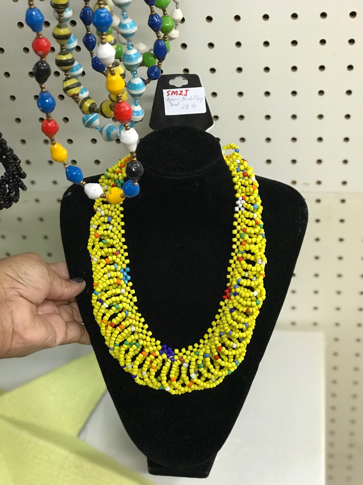 Image: Bold yellow necklace. That Tangie Bell will be adding to her new wardrobe.Spice And Color On Color On Color!