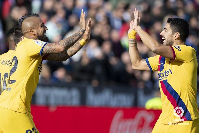 Suarez and Vidal celebrate scoring for Barcelona against Leganes