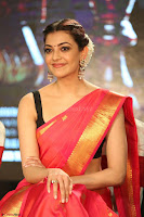 Kajal Aggarwal in Red Saree Sleeveless Black Blouse Choli at Santosham awards 2017 curtain raiser press meet 02.08.2017 035.JPG