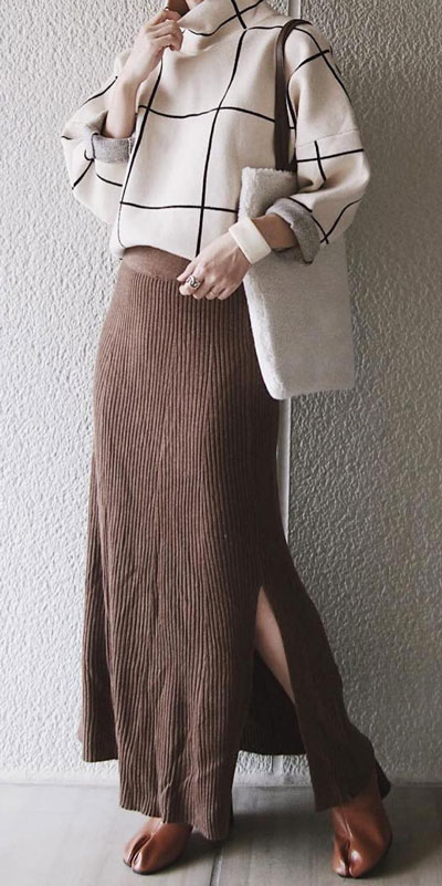 Winter is a great time to step up your personal style. See these 24 Trendy Winter Fashion Ideas for Not So Cold Days. Winter Outfit Ideas for Women via higiggle.com long skirt with white sweater #winter #fashion #skirt