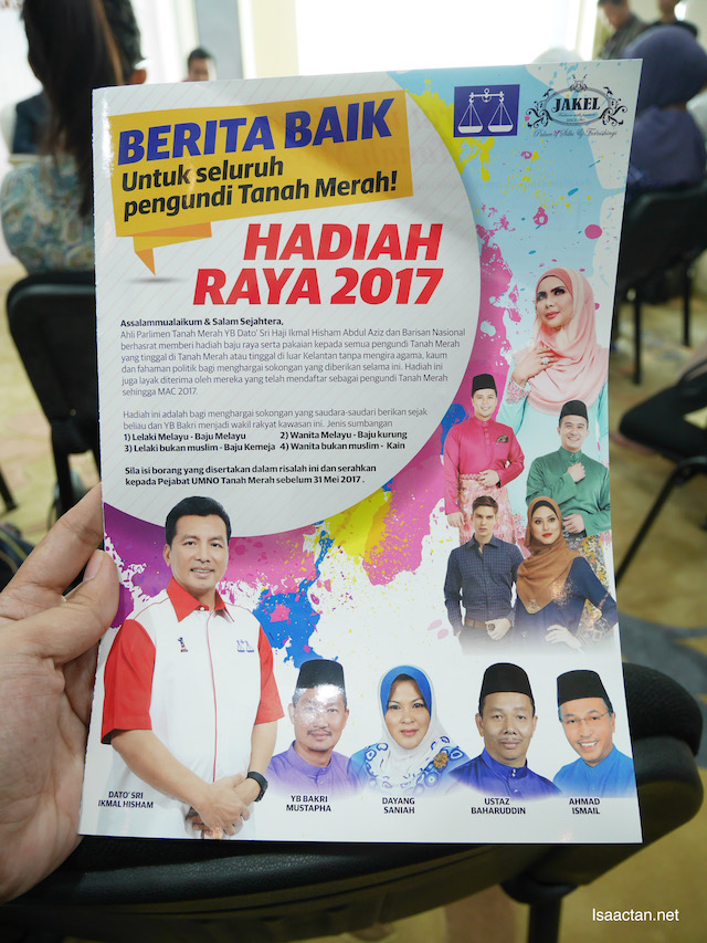 Inside, fill up the forms to redeem the baju raya