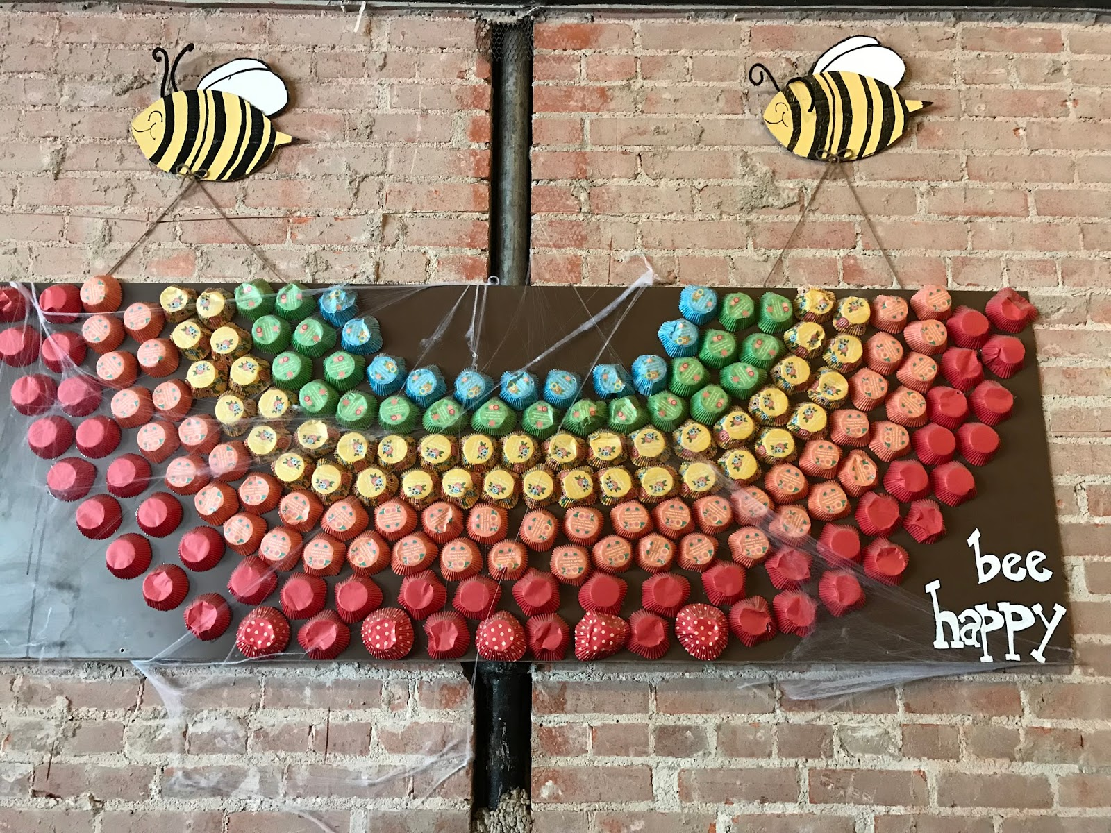 Image: Bee Happy Sign Hanging At Snug Cafe In McKinney Texas
