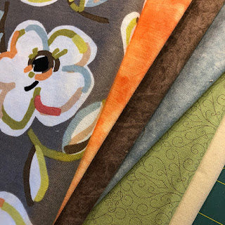 Pieced bird quilt blocks and fabric for a table topper
