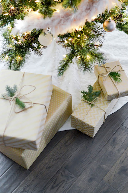 Four Gift Boxes Under Christmas Tree | Photo by Element5 Digital via Unsplash