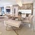 Salas de tv, jantar e gourmet integrados com revestimentos dourados e marmorizados!