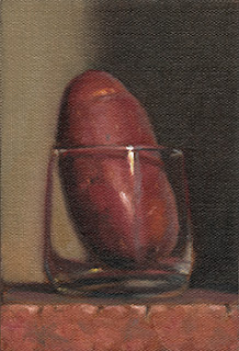 Still life oil painting of a Désirée potato in an Old Fashioned glass.