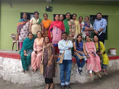 Kiran and participants after a workshop