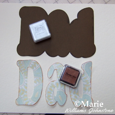 Inking around the edges of the DAD paper letters with mini rubber stamp inks brown card craft