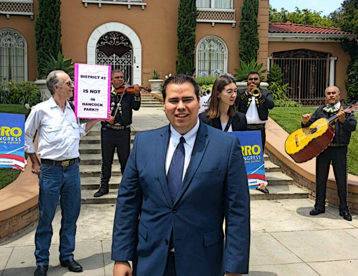 Omar Navarro on campaign trail, standing outside