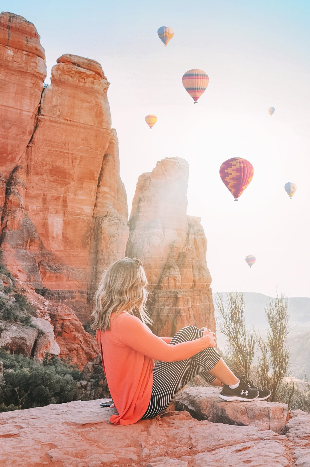 travel blogger Amanda's OK overlooks the Sedona sunset from Cathedral Rock