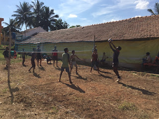 The boys playing volleyball in the heat of the day