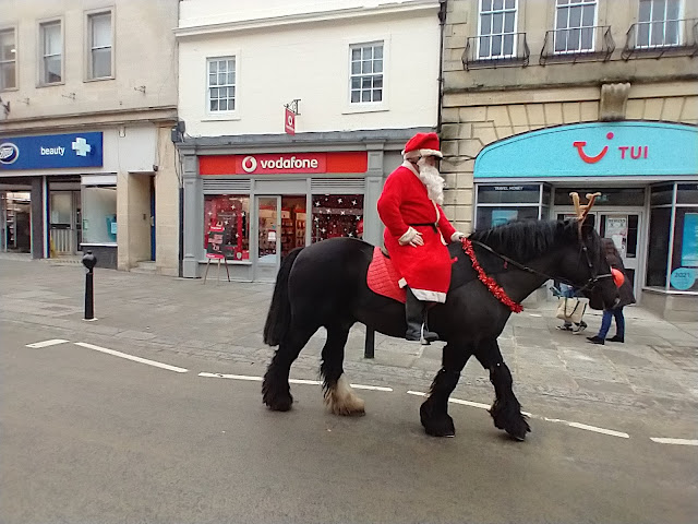 A horse rider dressed as Santa plus his horse disguised as Rudolph