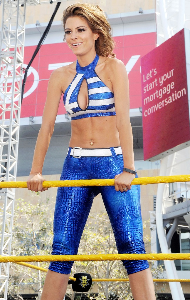 Maria Menounos In Shiny Spandex And Crop Top For WWE