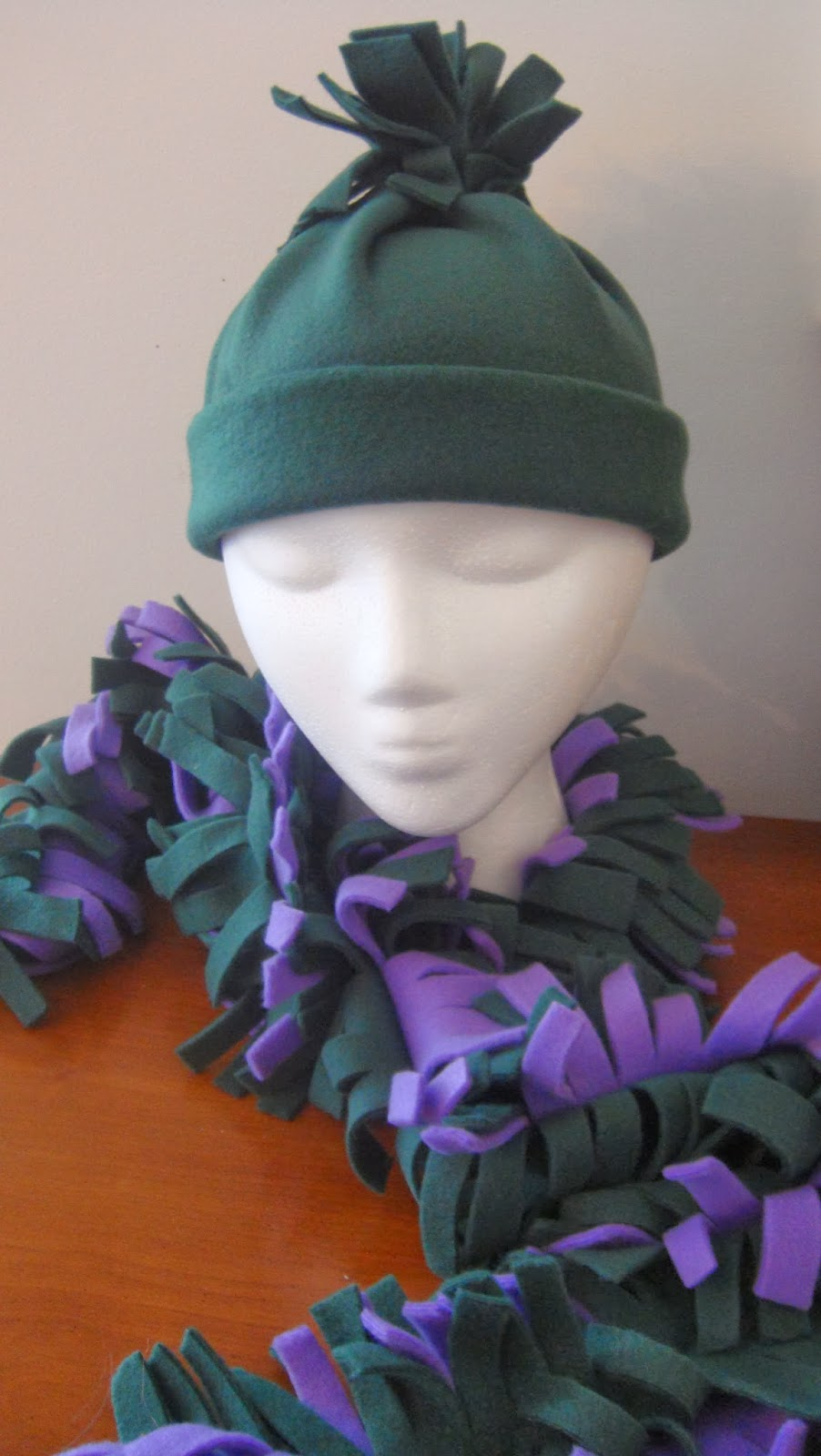 http://plumperfectandme.blogspot.com/2013/01/no-sew-frilly-fleece-hat-and-scarf.html