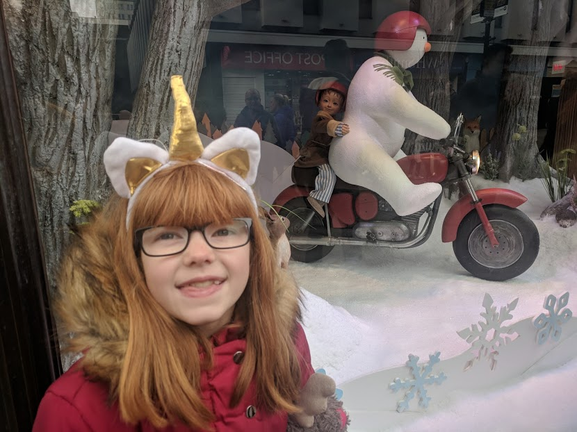 The Snowman at Fenwick's window 2018, etiquette and why I hate people who push in - snowman on bike