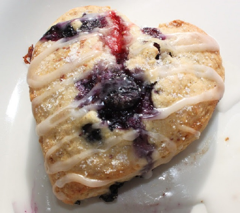 this is a buttery breakfast scone with blueberries, orange and strawberry for breakfast or brunch