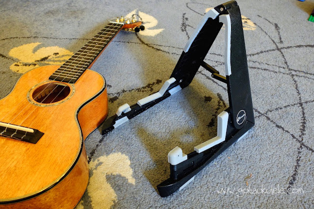 Folding Ukulele Stand next to Concert ukulele