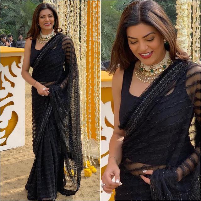 Sushmita Sen wearing a black saree