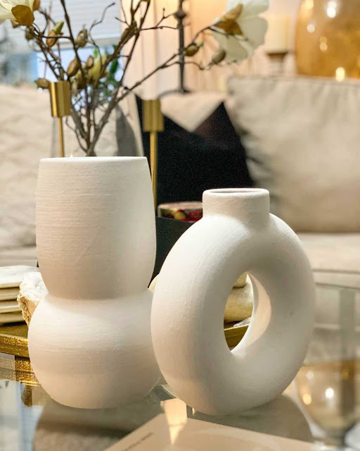 set of white modern vases on coffee table